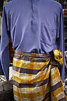 Closeup of baju melayu, traditional Malay attire for men. - Asia Images Group