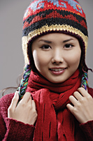 Head shot of Chinese woman in knitted hat - Asia Images Group