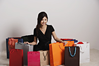 Chinese woman with a lot of shopping bags - Asia Images Group