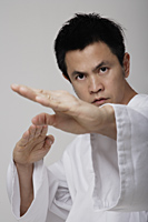 Close up of man using martial arts - Asia Images Group