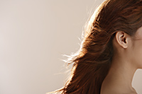 Profile shot of young woman's hair - Asia Images Group