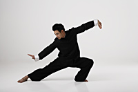 Man doing Tai Chi wearing traditional Chinese clothes - Asia Images Group