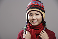 Head shot of Chinese woman wearing knitted hat - Asia Images Group
