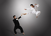 Two men fighting with martial arts - Asia Images Group