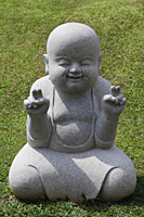 Stone statue of happy Buddha - Asia Images Group