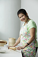 Mature Chinese woman cooking - Asia Images Group