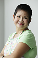 Head shot of mature Chinese woman smiling - Asia Images Group