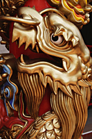 Close up of gold dragon on temple pillar - Asia Images Group