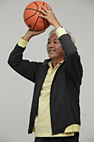 Mature Chinese man playing basketball - Asia Images Group