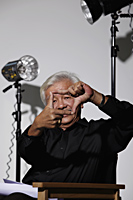 Mature Chinese man framing a shot with fingers - Asia Images Group