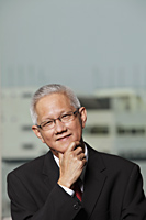 head shot of mature man with grey hair - Asia Images Group