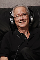 mature man with grey hair wearing head phones and smiling - Asia Images Group