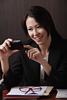 Young woman looking at phone - Asia Images Group