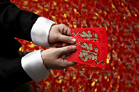 Cropped shot of man holding lucky Hong Bao, red envelope - Asia Images Group