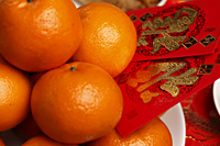 Oranges with red envelopes, Hong Bao, Chinese New Year - Asia Images Group