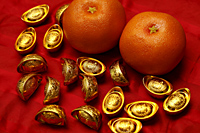 Chinese gold ingot and oranges - Asia Images Group