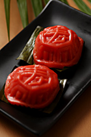 "Ang Ku Kueh. Chinese glutinous rice cake. With the character for ""sweet"". - Asia Images Group"