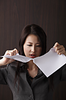 woman ripping paper - Asia Images Group