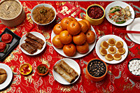 Table set with Chinese New Year food. - Asia Images Group