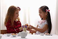 two young girls having a tea party - Asia Images Group