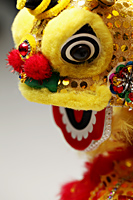Yellow lion head, Chinese New Year decoration - Asia Images Group