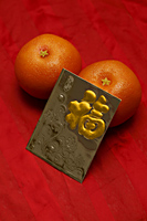 Red envelope, Hong Bao, oranges - Asia Images Group