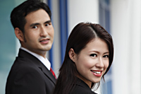 head shot of man and woman smiling - Asia Images Group