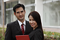 Head shot of man and woman in suits - Asia Images Group