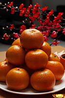 Oranges stacked on plate - Asia Images Group