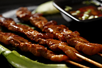 Beef satay with dipping sauce. - Asia Images Group