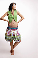 Young woman, standing, hands on hip, eyes closed - Asia Images Group
