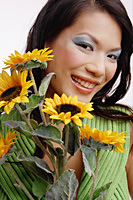 Young woman, with bouquet of flowers, portrait - Asia Images Group