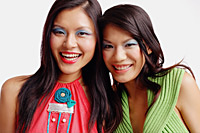 Two women looking at camera, smiling, portrait - Asia Images Group