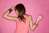 Young woman listening to mp3 player, portrait - Asia Images Group