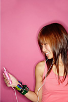 Young woman looking at mp3 player - Asia Images Group