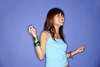 Young woman against blue background, snapping fingers - Asia Images Group