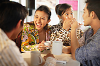 Friends having tea and coffee - Asia Images Group