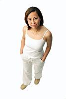 Woman looking up at camera, studio shot - Asia Images Group