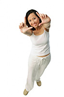 Woman making hand sign at camera - Asia Images Group