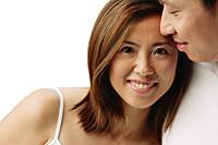 Woman leaning on man and looking at camera - Asia Images Group