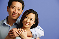 Couple looking at camera, portrait - Asia Images Group