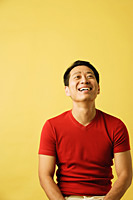 Man smiling, looking up - Asia Images Group