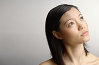 Woman looking away, head shot - Asia Images Group
