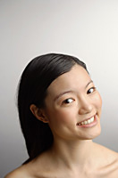 Woman looking at camera, head shot - Asia Images Group