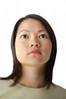 Head shot, young woman looking away - Asia Images Group