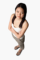 Young woman looking at camera, arms crossed - Asia Images Group