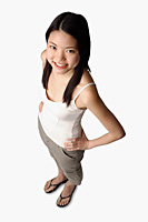 Young woman looking at camera, hands on hips - Asia Images Group