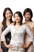 Three young women side by side, portrait - Asia Images Group