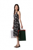 Young woman standing with shopping bags, portrait - Asia Images Group