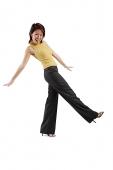 Young woman kicking, looking at camera - Asia Images Group